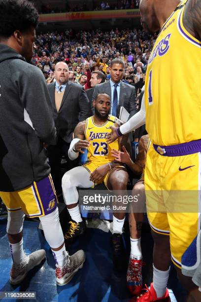 LeBron James of the Los Angeles Lakers is highfived by his teammates after passing Kobe Bryant for third on NBA's alltime scoring list on January 25...