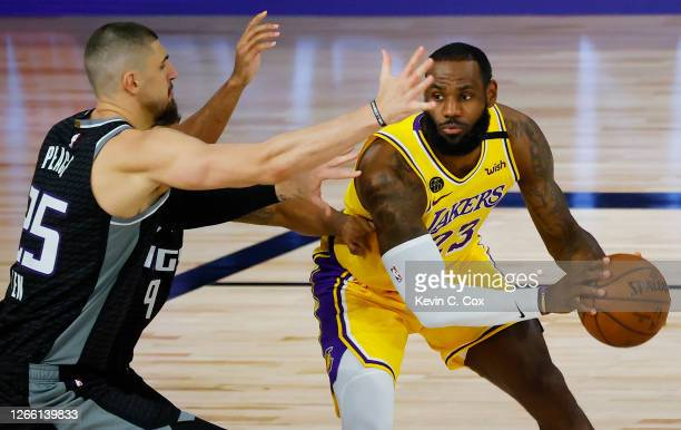 LeBron James of the Los Angeles Lakers is pressured by Alex Len of the Sacramento Kings at The Field House at ESPN Wide World Of Sports Complex on...