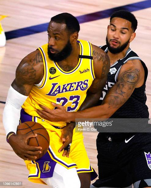 LeBron James of the Los Angeles Lakers is pressured by Cory Joseph of the Sacramento Kings during the first quarter at The Field House at ESPN Wide...