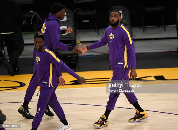 LeBron James of the Los Angeles Lakers is welcomed by Devontae Cacok during pre-game warm-ups before the start of a basketball game against the...