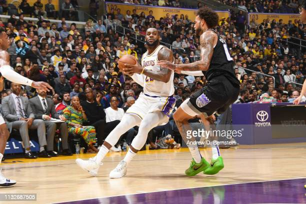 LeBron James of the Los Angeles Lakers jocks for a position during the game against Willie CauleyStein of the Sacramento Kings on March 24 2019 at...