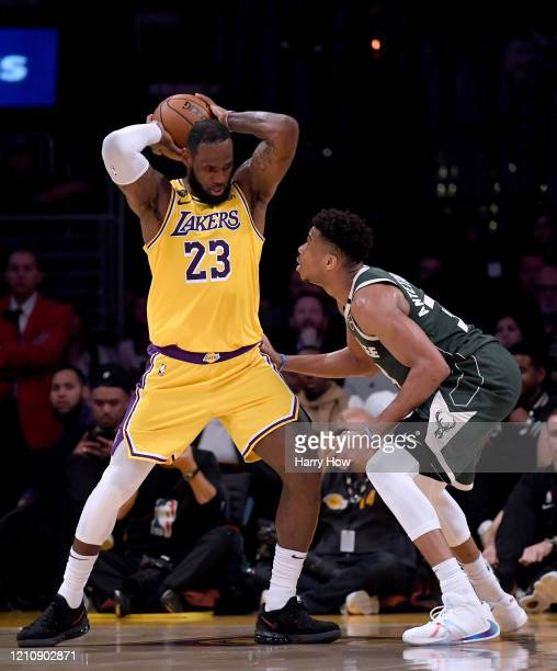 LeBron James of the Los Angeles Lakers keeps the ball from Giannis Antetokounmpo of the Milwaukee Bucks during the third quarter at Staples Center on...