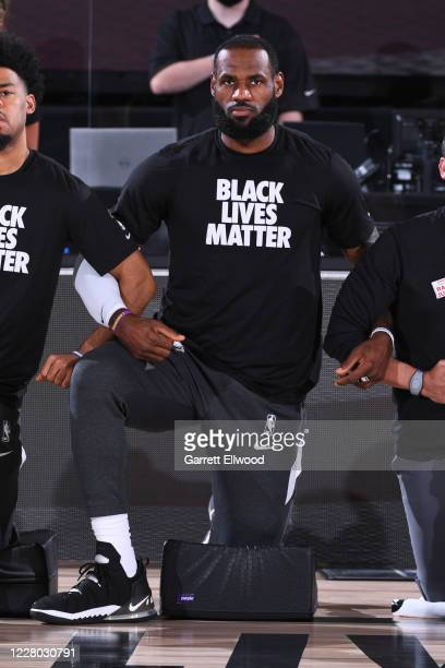 LeBron James of the Los Angeles Lakers kneels for the national anthem before the game on August 13 2020 at The Field House in Orlando Florida NOTE TO...