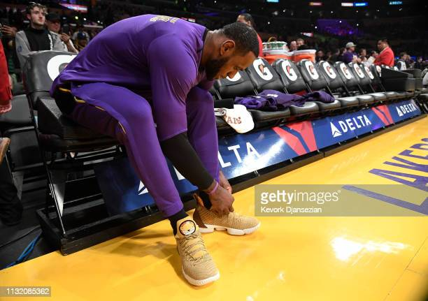 LeBron James of the Los Angeles Lakers laces up prior to stat of a basketball game against Brooklyn Nets at Staples Center on March 22 2019 in Los...
