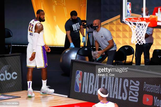 LeBron James of the Los Angeles Lakers leaves the court during the fourth quarter against the Miami Heat in Game Three of the 2020 NBA Finals at...
