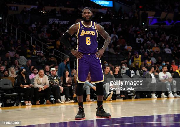 LeBron James of the Los Angeles Lakers looks at the fans seated courtside as they Lakers were getting blown out by Phoenix Suns during the second...