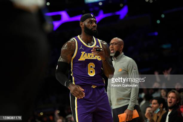 LeBron James of the Los Angeles Lakers looks at the Phoenix Suns bench after scoring a three point basket during the first half of the game at...