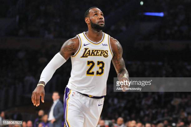 LeBron James of the Los Angeles Lakers looks for a rebound during a game against the Sacramento Kings at Staples Center on March 24 2019 in Los...