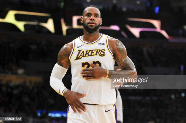 LeBron James of the Los Angeles Lakers looks on during a game against the Sacramento Kings at Staples Center on March 24 2019 in Los Angeles...
