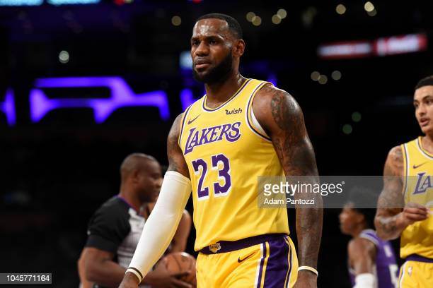 LeBron James of the Los Angeles Lakers looks on during a preseason game against the Sacramento Kings on October 4 2018 at Staples Center in Los...