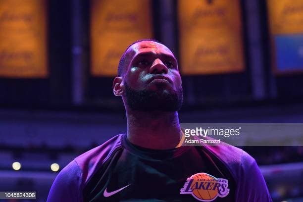 LeBron James of the Los Angeles Lakers looks on during the National Anthem before a preseason game against the Sacramento Kings on October 4 2018 at...