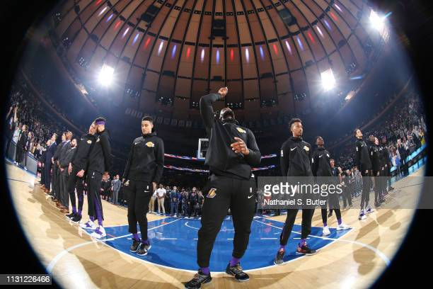 LeBron James of the Los Angeles Lakers looks on during the national anthem prior to the game against the New York Knicks on March 17 2019 at Madison...