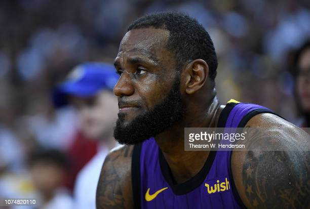 LeBron James of the Los Angeles Lakers looks on from the bench after he was hurt against the Golden State Warriors during the second half of their...