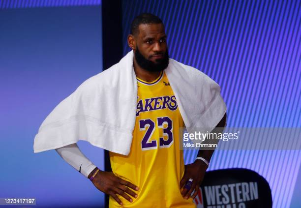 LeBron James of the Los Angeles Lakers looks on from the bench against the Denver Nuggets during the fourth quarter in Game One of the Western...
