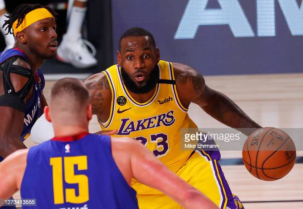 LeBron James of the Los Angeles Lakers looks to move past Nikola Jokic of the Denver Nuggets during the third quarter in Game One of the Western...