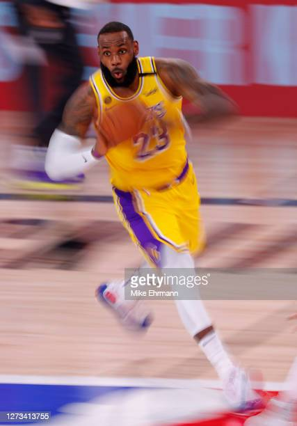 LeBron James of the Los Angeles Lakers looks to pass against the Denver Nuggets during the third quarter in Game One of the Western Conference Finals...