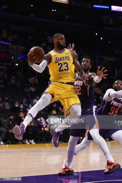 LeBron James of the Los Angeles Lakers looks to pass the ball against the Phoenix Suns during Round 1, Game 3 of the 2021 NBA Playoffs on May 27,...
