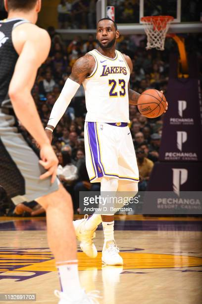 LeBron James of the Los Angeles Lakers looks to pass the ball during the game against the Sacramento Kings on March 24 2019 at STAPLES Center in Los...