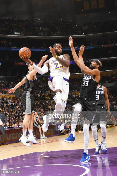 LeBron James of the Los Angeles Lakers looks to pass the ball during the game against Corey Brewer of the Sacramento Kings on March 24 2019 at...