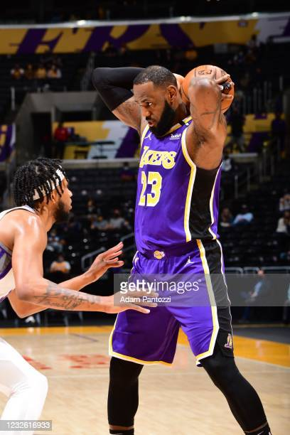 LeBron James of the Los Angeles Lakers looks to pass the ball during the game against the Sacramento Kings on April 30, 2021 at STAPLES Center in Los...
