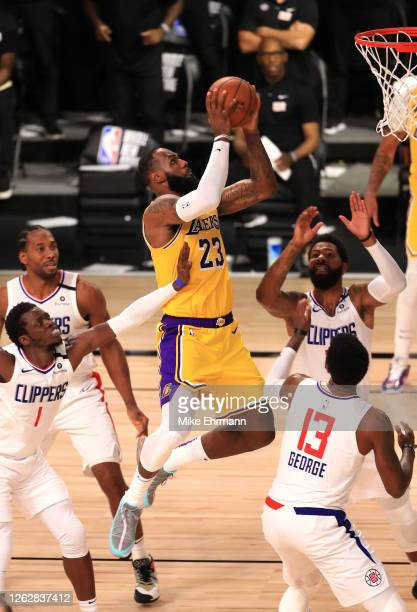 LeBron James of the Los Angeles Lakers makes a shot against the LA Clippers during the fourth quarter of the game at The Arena at ESPN Wide World Of...