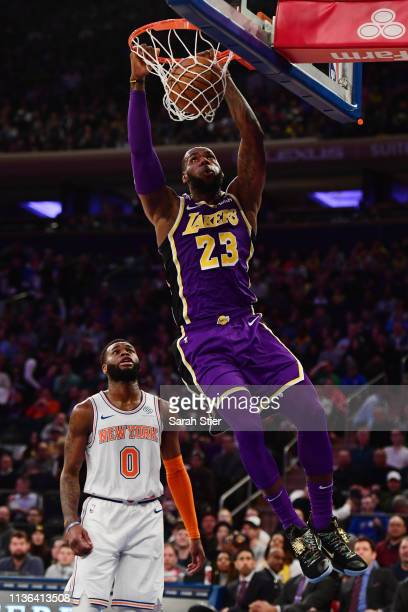 LeBron James of the Los Angeles Lakers makes a slam dunk during the first half of the game against the New York Knicks at Madison Square Garden on...
