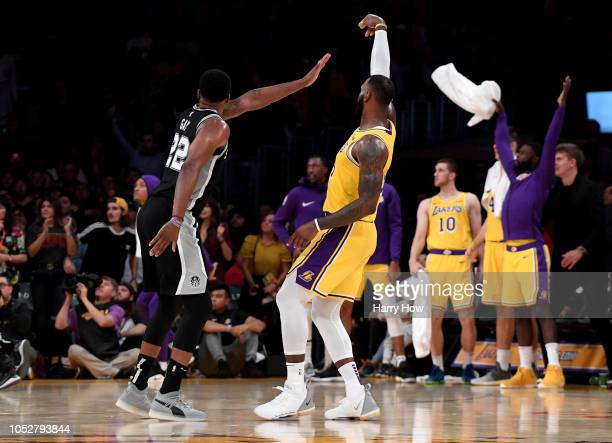 LeBron James of the Los Angeles Lakers makes a three pointer in front of Rudy Gay of the San Antonio Spurs to tie the game 128128 during a 143142...