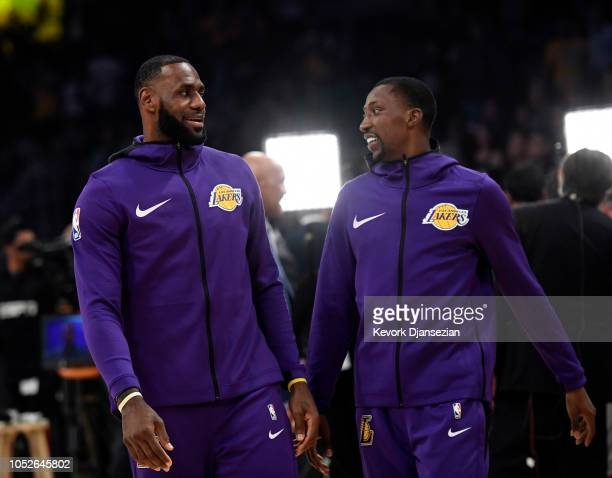 LeBron James of the Los Angeles Lakers makes his home debut against the Houston Rockets as he talks with Kentavious CaldwellPope at Staples Center on...