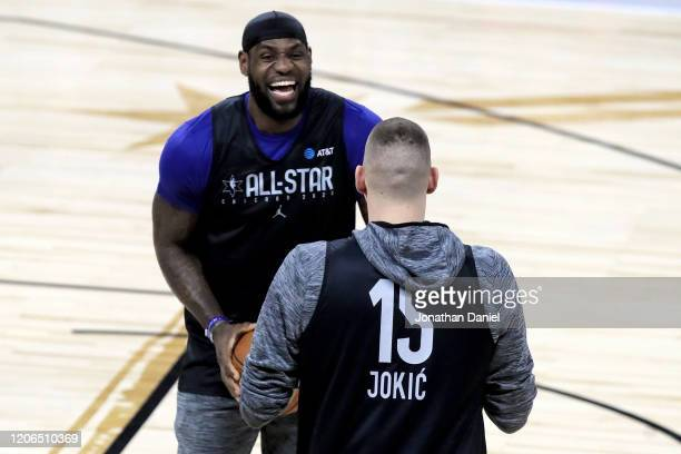 LeBron James of the Los Angeles Lakers meets with Nikola Jokic of the Denver Nuggets during 2020 NBA All-Star - Practice & Media Day at Wintrust...