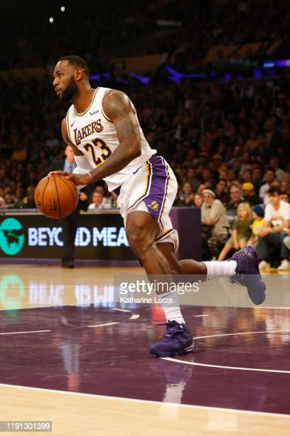 LeBron James of the Los Angeles Lakers moves the ball down the court during the first half against the Dallas Mavericks at Staples Center on December...