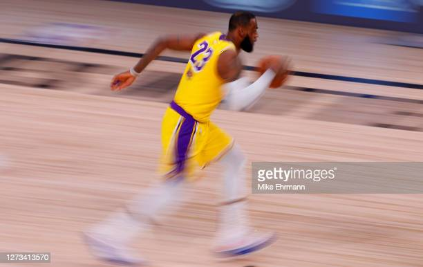 LeBron James of the Los Angeles Lakers moves the ball up court against the Denver Nuggets during the third quarter in Game One of the Western...