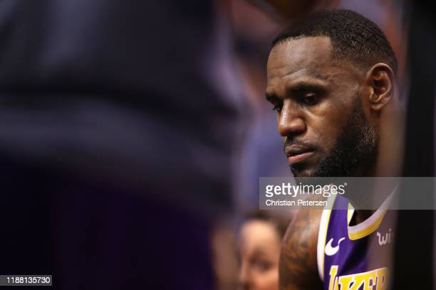 LeBron James of the Los Angeles Lakers on the bench during the NBA game against the Phoenix Suns at Talking Stick Resort Arena on November 12 2019 in...