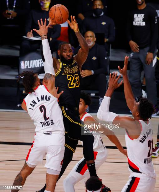 LeBron James of the Los Angeles Lakers passes against Gary Trent Jr. #2 of the Portland Trail Blazers during the second quarter in Game Four of the...