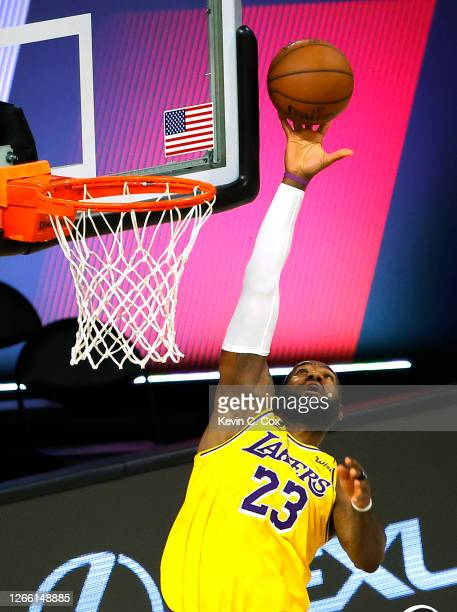 LeBron James of the Los Angeles Lakers passes against the Sacramento Kings during the second quarter at The Field House at ESPN Wide World Of Sports...