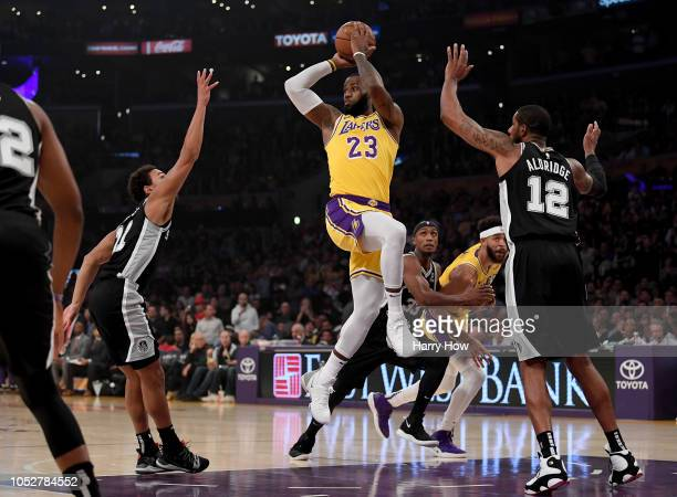 LeBron James of the Los Angeles Lakers passes in front of LaMarcus Aldridge of the San Antonio Spurs during the first half at Staples Center on...