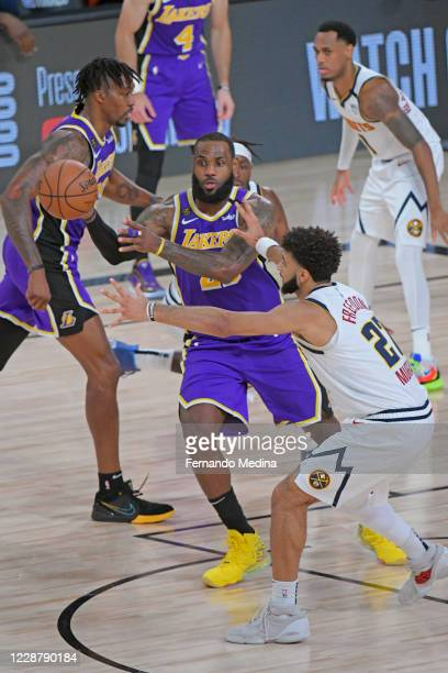 LeBron James of the Los Angeles Lakers passes the ball against Jamal Murray of the Denver Nuggets during Game Five of the Western Conference Finals...