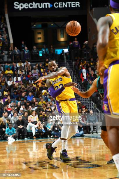 LeBron James of the Los Angeles Lakers passes the ball against the Charlotte Hornets on December 15, 2018 at Spectrum Center in Charlotte, North...