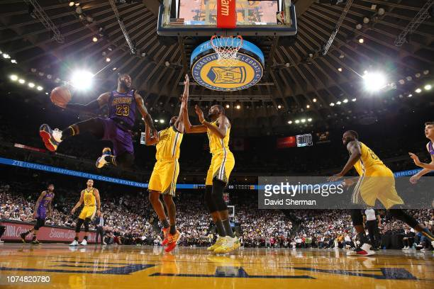 LeBron James of the Los Angeles Lakers passes the ball against the Golden State Warriors on December 25 2018 at ORACLE Arena in Oakland California...