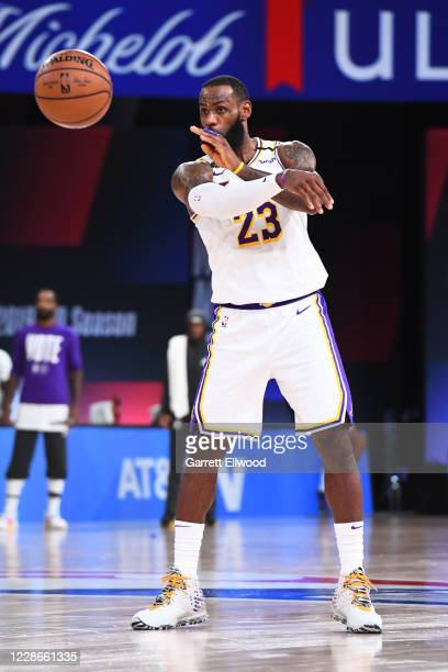 LeBron James of the Los Angeles Lakers passes the ball against the Denver Nuggets during Game Three of the Western Conference Finals of the NBA...