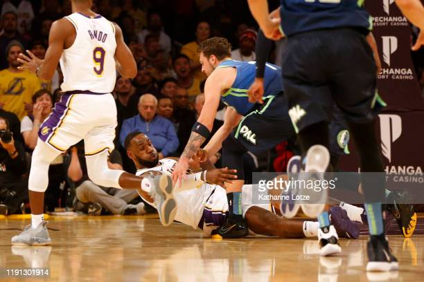 LeBron James of the Los Angeles Lakers passes the ball as Luka Doncic of the Dallas Mavericks defends during the first half at Staples Center on...