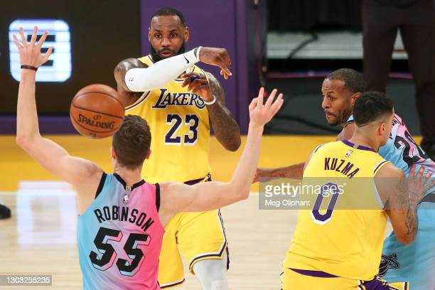 LeBron James of the Los Angeles Lakers passes the ball over Duncan Robinson of the Miami Heat at Staples Center on February 20, 2021 in Los Angeles,...