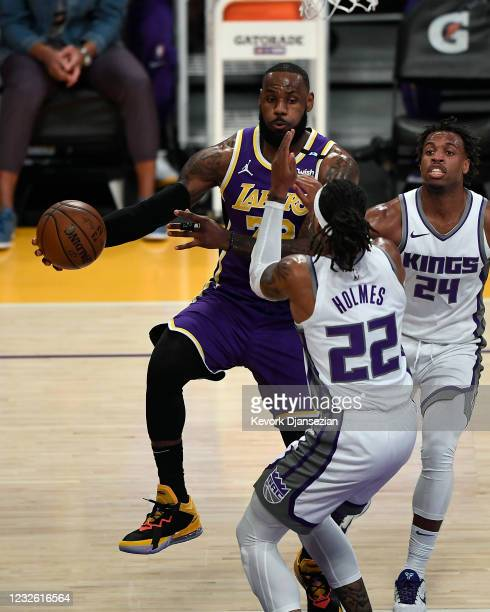 LeBron James of the Los Angeles Lakers passes the ball under pressure from Richaun Holmes of the Sacramento Kings during the first half at Staples...