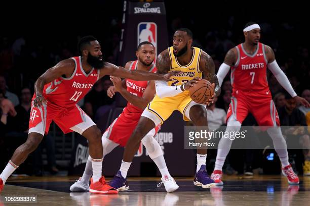 LeBron James of the Los Angeles Lakers picks up his dribble in front of James Harden and Eric Gordon of the Houston Rockets during a 124115 Laker...