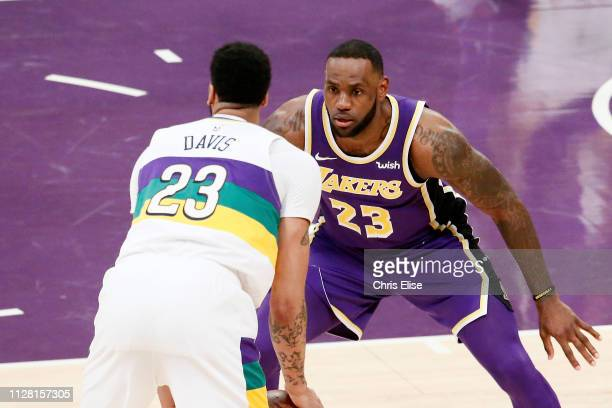 LeBron James of the Los Angeles Lakers plays defense against Anthony Davis of the New Orleans Pelicans on February 27 2019 at STAPLES Center in Los...