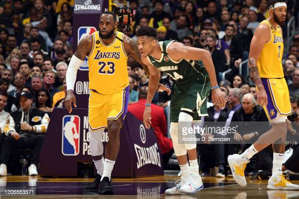 LeBron James of the Los Angeles Lakers plays defense against Giannis Antetokounmpo of the Milwaukee Bucks on March 6 2020 at STAPLES Center in Los...