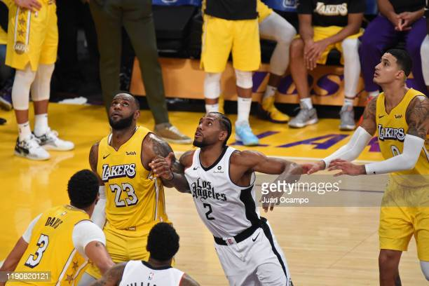LeBron James of the Los Angeles Lakers plays defense against Kawhi Leonard of the LA Clippers on December 25 2019 at STAPLES Center in Los Angeles...