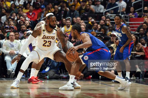 LeBron James of the Los Angeles Lakers plays defense against Kawhi Leonard of the LA Clippers on March 8 2020 at STAPLES Center in Los Angeles...