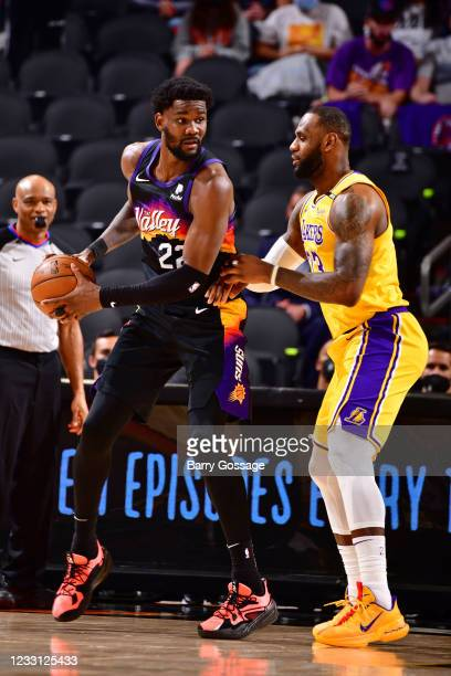LeBron James of the Los Angeles Lakers plays defense during the game agaisnt Deandre Ayton of the Phoenix Suns during Round 1, Game 2 of the 2021 NBA...
