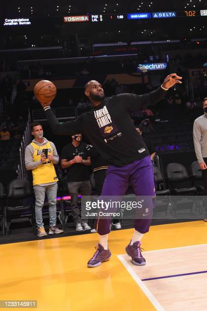 LeBron James of the Los Angeles Lakers plays football before the game against the Phoenix Suns during Round 1, Game 3 of the 2021 NBA Playoffs on May...