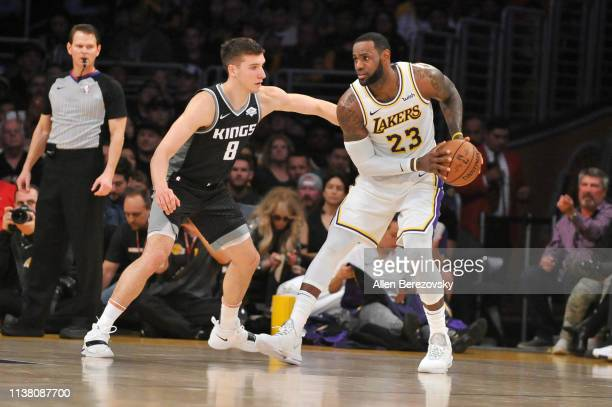 LeBron James of the Los Angeles Lakers posts up against Bogdan Bogdanovic of the Sacramento Kings at Staples Center on March 24 2019 in Los Angeles...
